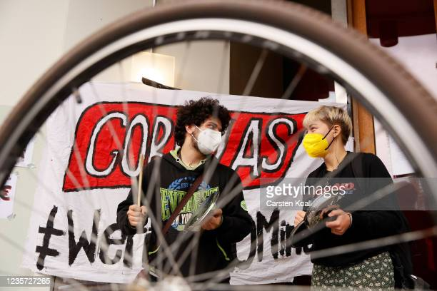 Former Gorillas grocery couriers and others bang on pots in protest outside the Gorillas corporate headquarters following the company's firing of...