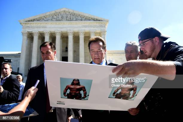 Former Gov Arnold Schwarzenegger RCalif signs autographs outside of The United States Supreme Court after an oral arguments in Gill v Whitford to...