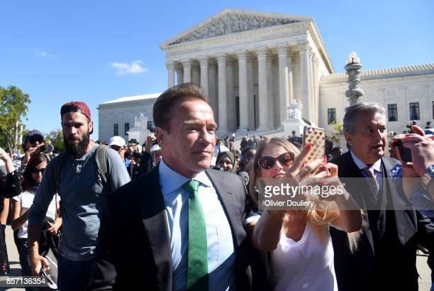 Former Gov Arnold Schwarzenegger RCalif takes selfie outside of The United States Supreme Court after an oral arguments in Gill v Whitford to call...