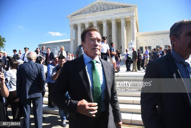 Former Gov Arnold Schwarzenegger RCalif walks outside of The United States Supreme Court after an oral arguments in Gill v Whitford to call for an...