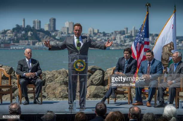 Former Gov Arnold Schwarzenegger speaks at a Gov Jerry Brown signing of a bill extending the capandtrade climate change program until 2030 on Tuesday...