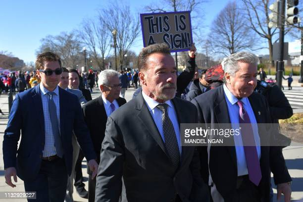 Former Gov. Arnold Schwarzenegger, walks after speaking at a rally to coincide with the Supreme Court hearings on the redistricting cases in Maryland...