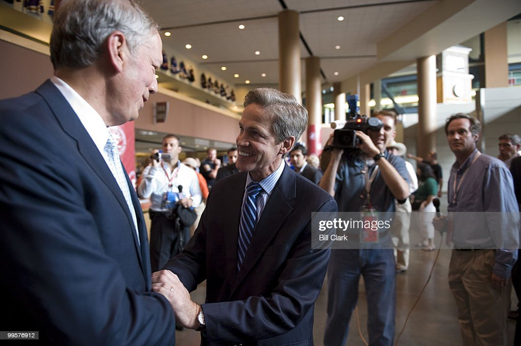 Former Gov. George Pataki, R-N.Y., speaks with Sen. Norm Coleman, R-Minn., during the Republican National Convention at the Excel Center in St. Paul, Minn., on Monday, Sept. 1, 2008.