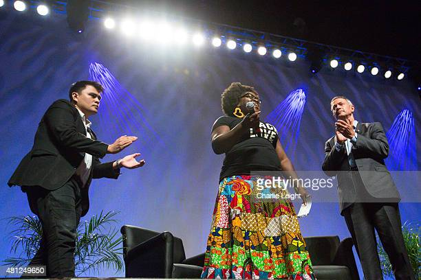 Former Gov Martin O'Malley and moderator Jose Antonio Vargas listen to Tia Oso the National Coordinator for the Black Immigration Network during an...