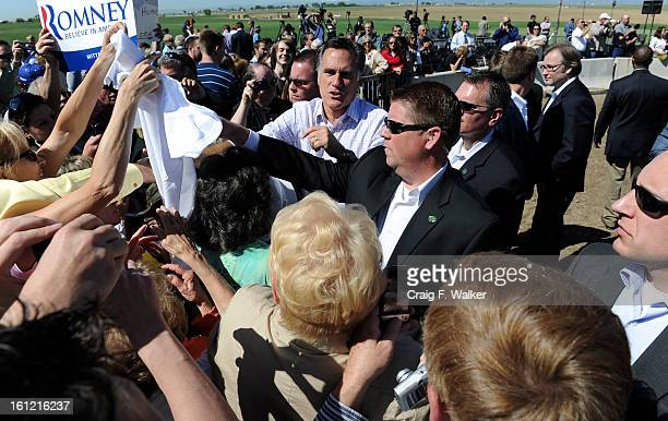 Former Gov Mitt Romney says farewell after speaking to more than 400 supporters during a campaign stop near the field office of KP Kauffman Co a...