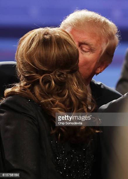 Former Gov Sarah Palin and Republican presidential nominee Donald Trump embrace after the third US presidential debate at the Thomas Mack Center on...