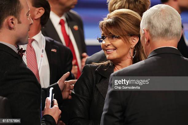 Former Gov Sarah Palin speaks with guests after the third US presidential debate at the Thomas Mack Center on October 19 2016 in Las Vegas Nevada...