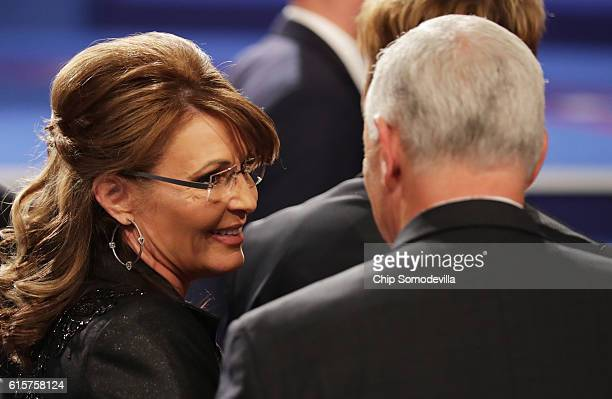 Former Gov Sarah Palin speaks with Republican vice presidential nominee Mike Pence after the third US presidential debate at the Thomas Mack Center...
