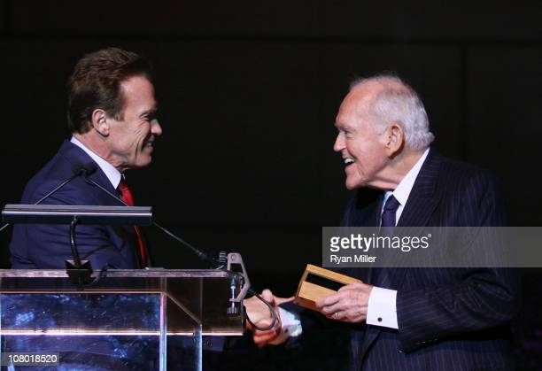 Former Govenor Arnold Schwartzenegger presents the official Govenors ring to Founding Chairman Henry Segerstrom at the Orange County Perfroming Arts...