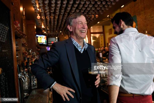 Former Governor John Hickenlooper poured his own beer with head brewer and assistant general manager Brian Vaughan during a visit to the Court Avenue...