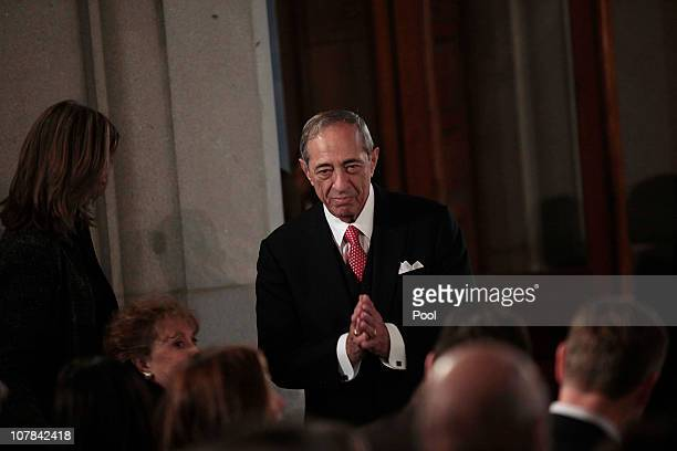 Former Governor Mario Cuomo acknowledges applause during the inauguration of his son Andrew M Cuomo as the 56th Governor of New York in the War Room...