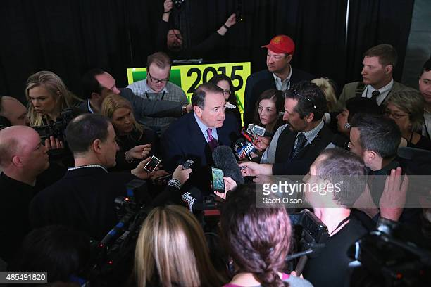 Former Governor Mike Huckabee of Arkansas fields questions from reporters at the Iowa Ag Summit on March 7 2015 in Des Moines Iowa The event allows...