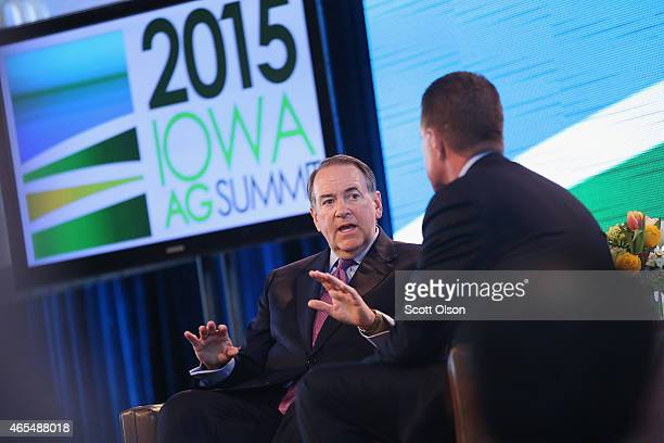 Former Governor Mike Huckabee of Arkansas fields questions from Bruce Rastetter at the Iowa Ag Summit on March 7, 2015 in Des Moines, Iowa. The event...