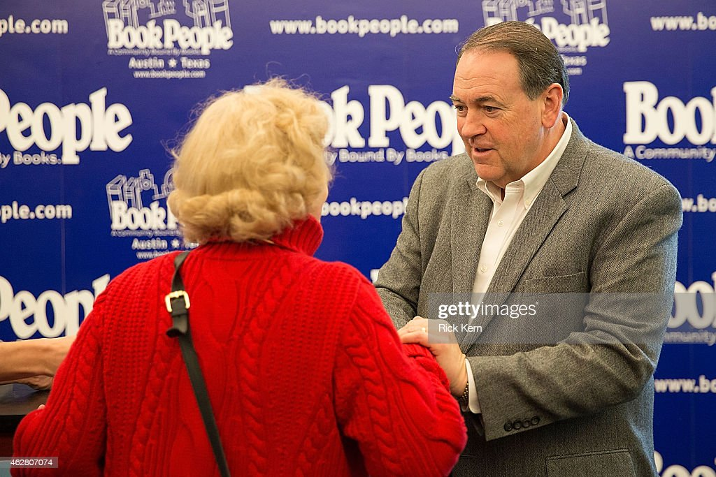 Former Governor of Arkansas Mike Huckabee signs copies of his new book 'God, Guns, Grits, and Gravy' at Book People on February 5, 2015 in Austin, Texas.