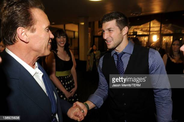 Former Governor of California Arnold Schwarzenegger and NFL Player Tim Tebow of the Denver Broncos arrive at the premiere of Relativity Media's 'Act...