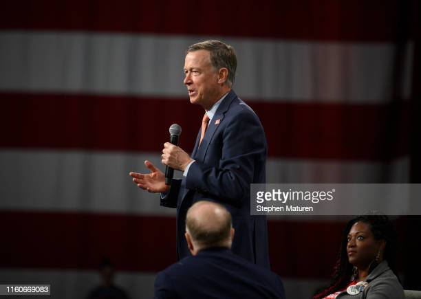 Former governor of Colorado and Democratic presidential candidate John Hickenlooper speaks on stage during a forum on gun safety at the Iowa Events...