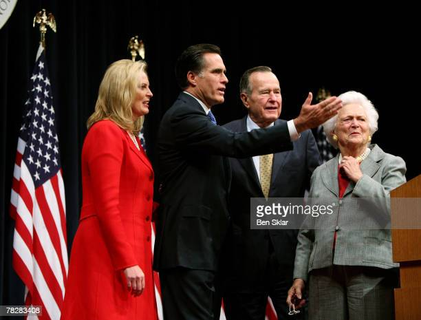 Former Governor of Massachusetts and 2008 Republican President hopeful Mitt Romney stands with his wife Anne Romney and former US President George...