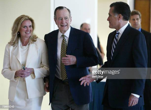 Former Governor of Massachusetts and 2008 Republican presidential hopeful Mitt Romney walks with his wife Ann and former US George HW Bush at the...