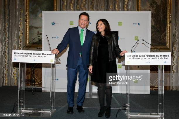 Former Governor of the US State of California Arnold Schwarzenegger and the mayor of the city of Paris Anne Hidalgo pose after a press conference on...