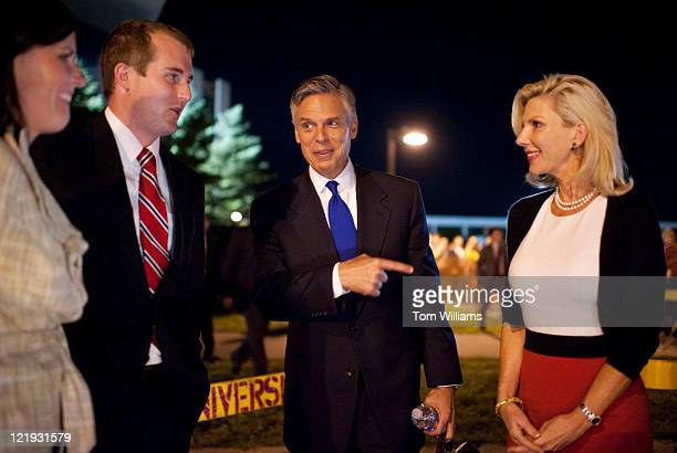 Former Governor of Utah Jon Huntsman center and his wife Mary Kaye right wait to be picked up outside of Stephens Auditorium at Iowa State University...