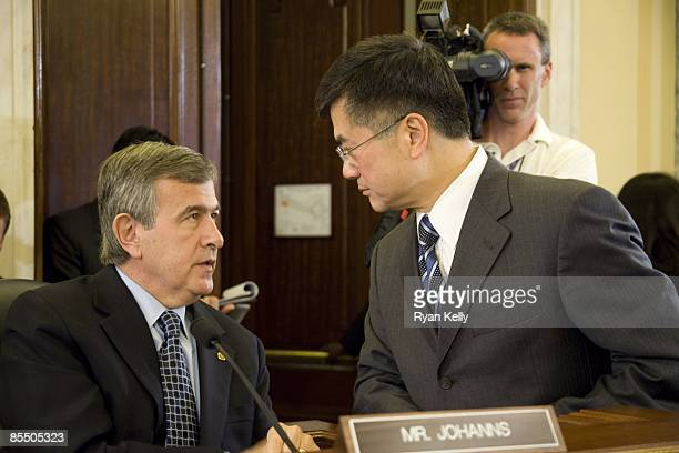 Former Governor of Washington and commerce secretary designee Gary Locke speaks with former Agriculture secretary and current Senator Mike Johanns...
