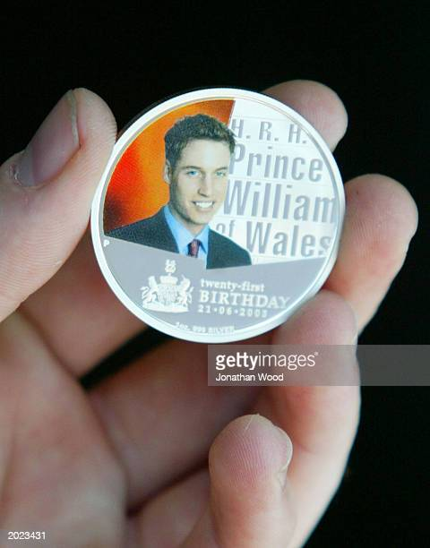 Former GovernorGeneral Bill Hayden AC of Australia unviels a commemorative coin to celebrate the 21st birthday of Prince William during the ANDA Coin...