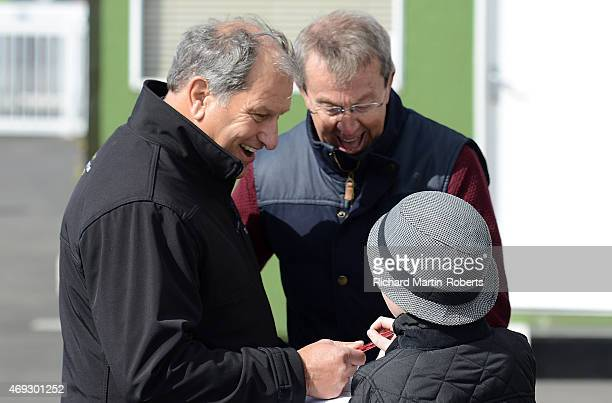 Former Grand National Winning Jockey Bob Champion signs an autograph on Day 3 of the Aintree races at Aintree Racecourse on April 11 2015 in...