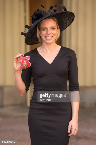 Former Great Britain hockey captain Kate RichardsonWalsh poses after the investiture ceremony where she received an OBE from the Prince of Wales for...
