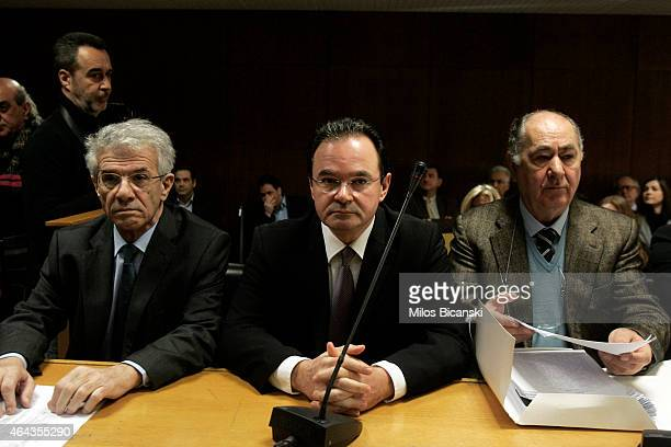 Former Greek finance minister George Papaconstantinou sits with his lawyers as he appears before a special court on February 25 2015 in Athens Greece...