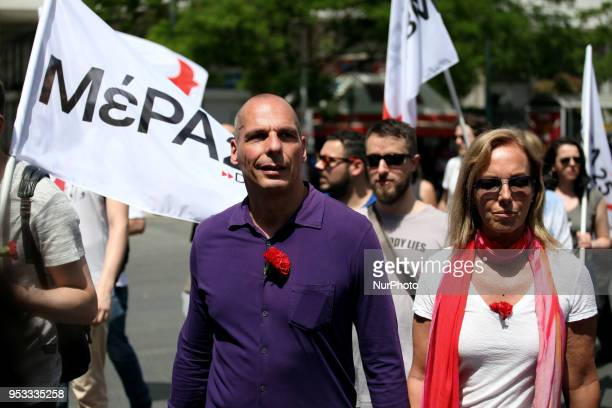 Former Greek Finance Minister Yanis Varoufakis and his wife take part in a demonstration marking May Day in Athens Greece on May 1 2018 Trade unions...