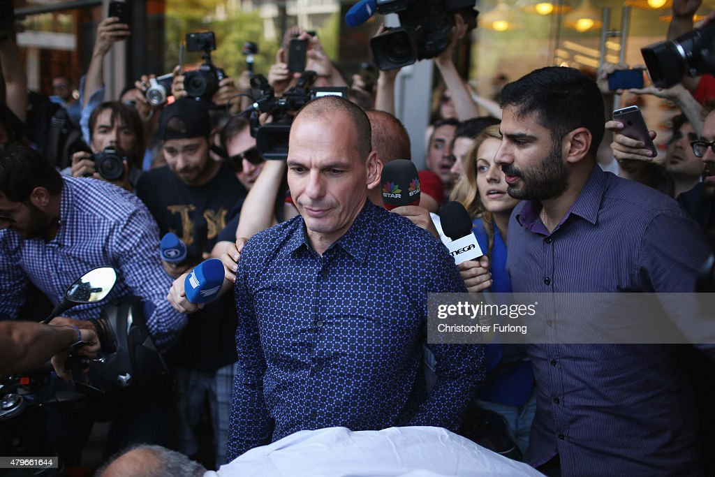 Former Greek finance minister Yanis Varoufakis faces a barage of media questions as he leaves the finance ministry after resigning this morning on July 6, 2015 in Athens, Greece. Politicians in Europe and Greece are planning emergency talks after Greek voters rejected EU proposals to pay back it's creditors creating an uncertain future for Greece.