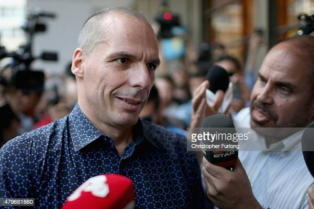 Former Greek finance minister Yanis Varoufakis faces a barage of media questions as he leaves the finance ministry after resigning this morning on...