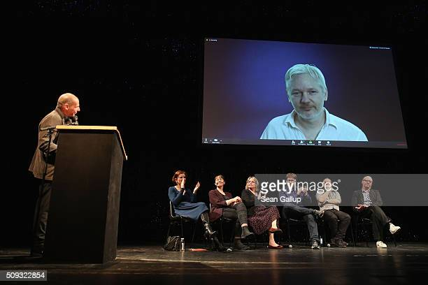 Former Greek Finance Minister Yanis Varoufakis looks on as Australian activist Julian Assange speaks via a live broadcast at the official launch of...