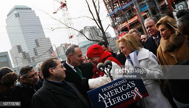 Former Ground Zero worker John Feal hugs Sen Chuck Schumer while Rep Jerrold Nadler Sen Kirsten Gillibrand and Rep Carolyn Maloney look on December...