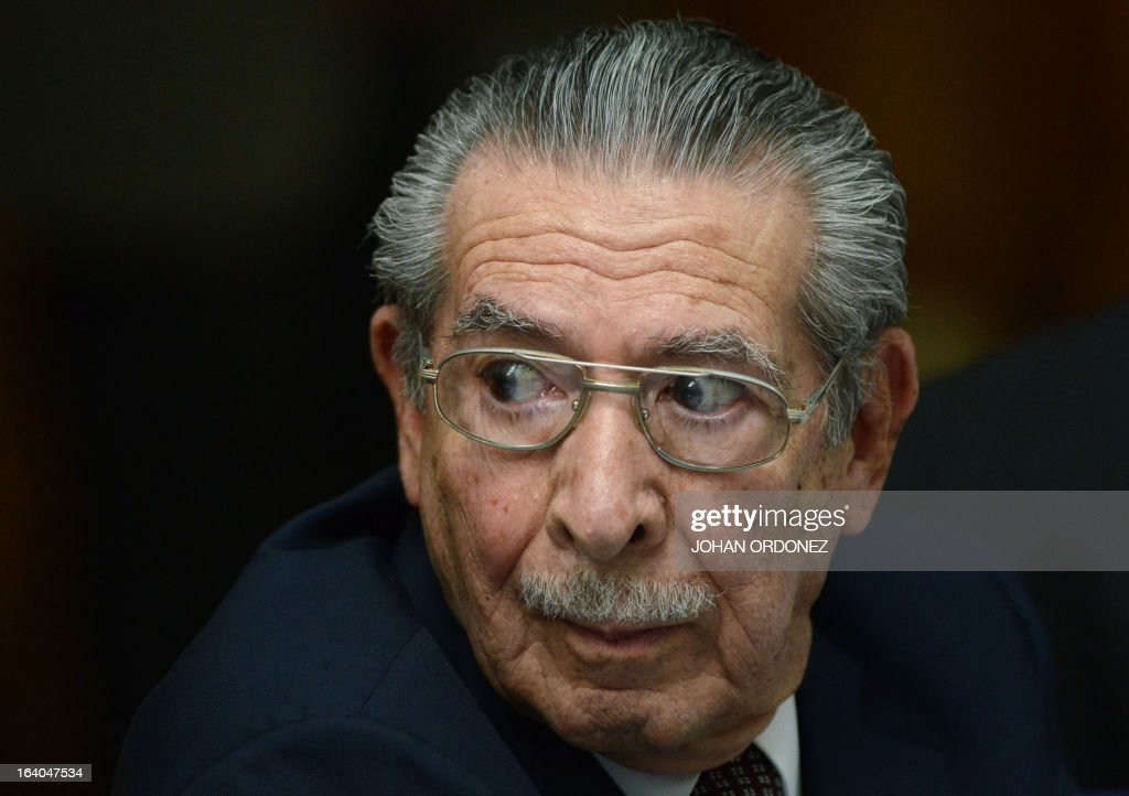 Former Guatemalan de facto President (1982-1983), retired General Jose Efrain Rios Montt, 86, gestures during the opening of the trial on charges of genocide during his de facto 1982-83 regime, in Guatemala City on March 19, 2013. Rios Montt, who stands trial despite defense attempts to postpone the start of the historic proceedings, is accused of ordering the execution of 1,771 members of the indigenous Ixil Maya people in the Quiche region. The trial marks the first time genocide proceedings have been brought in relation to the 36-year civil war in Guatemala that ended in 1996, leaving an estimated 200,000 people dead, according to United Nations estimates. AFP PHOTO/Johan ORDONEZ