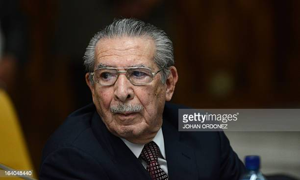 Former Guatemalan de facto President retired General Jose Efrain Rios Montt gestures during the opening of the trial on charges of genocide during...