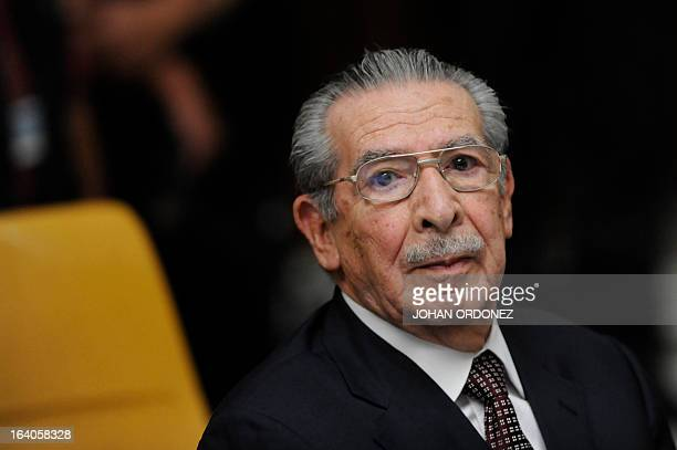Former Guatemalan de facto President retired General Jose Efrain Rios Montt listens during the opening of the trial on charges of genocide during his...