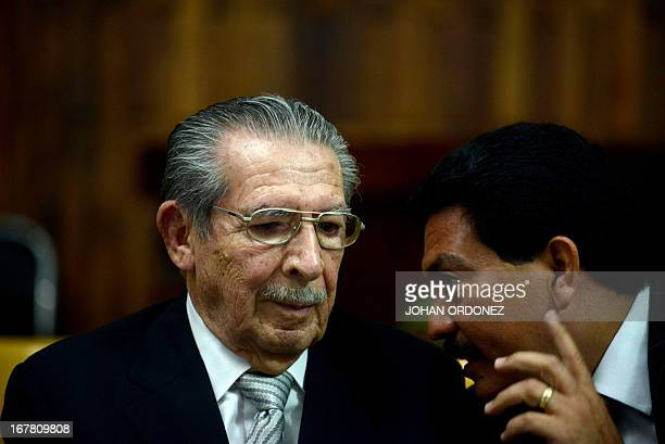 Former Guatemalan de facto President retired General Jose Efrain Rios Montt listens to his lawyer Francisco Garcia during the trial acainst him on...