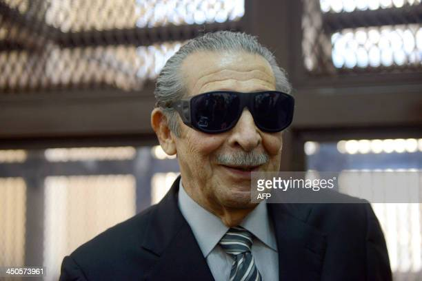 Former Guatemalan de facto president retired General Jose Efrain Rios Montt is seen wearing dark glasses prescribed after his cataract surgery during...