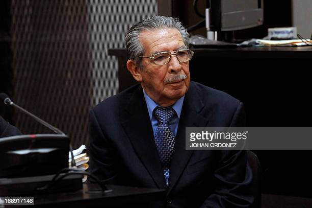 Former Guatemalan dictator retired General Jose Efrain Rios Montt listens as Guatemalan judge Carol Patricia Flores announces that she is dropping...