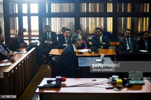 Former Guatemalan President Alvaro Colom attends a court hearing after his arrest on corruption charges in Guatemala City on February 13 2018...