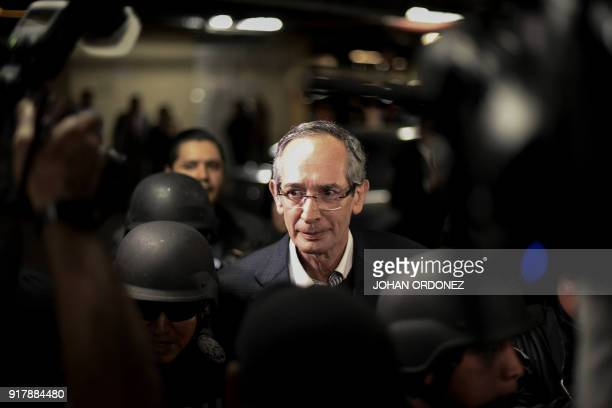 Former Guatemalan President Alvaro Colom is arrested on corruption charges in Guatemala City on February 13 2018 Guatemalan authorities on Tuesday...