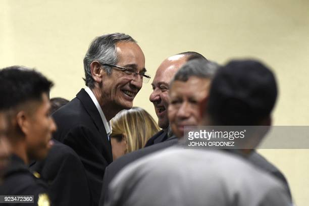Former Guatemalan president Alvaro Colom smiles with his lawyer Mario Castaneda during a court hearing in Guatemala City on February 23 2018 Colom...