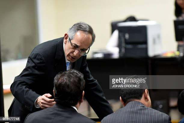 Former Guatemalan president Alvaro Colom stands during a court hearing in Guatemala City on February 23 2018 Colom and nine ministers of his former...
