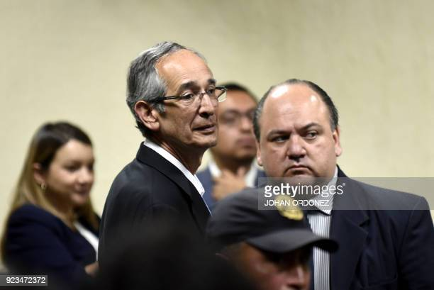 Former Guatemalan president Alvaro Colom stands next to his lawyer Mario Castaneda during a court hearing in Guatemala City on February 23 2018 Colom...