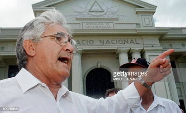 Former guerrilla commandante Eden Pastora talks with sympathizers 22 August in front of the National Palace in Managua where 20 years ago he led an...