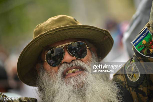 Former guerrilla fighter gestures during the 29th anniversary of the peace accords on January 16, 2021 in San Salvador, El Salvador. January 16 marks...