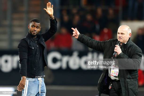 Former Guingamp's Guinean midfielder Abdoul Razzagui Camara forced to stop his carreer due to a heart issue greets supporters prior to the start of...