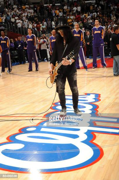 Former Guns N' Roses guitarist Slash performs the National Anthem prior to the home opener between the Los Angeles Lakers and the Los Angeles...