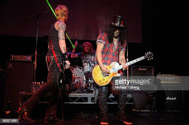 Former Guns N' Roses members Duff McKagan Steven Adler and Slash perform at the LAYN Rocks benefit concert for the Los Angeles Youth Network held at...